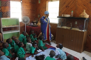Tika in character as she teaches programs to the children at the Centre.