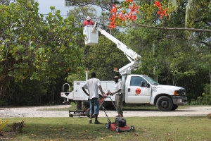 Power outages and cable/internet outages...just a couple of the inconveniences that try our patience.  The internet and cable went out on Tuesday June 10th.  It took 8 days for Cable Bahamas to finally make it out to fix a problem that took them all of 10 minutes to repair.  We have not had any problems since.  In the foreground, our grounds workers Celavia and Odisa were dealing with a problem of their own-lawn mower failures.