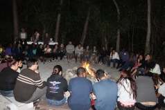 FAU at their evening debrief time around the Camp fire.