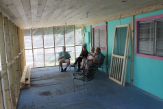 The afternoon we took the team to the airport, we enjoyed our first coffee break on the newly screened in front porch.