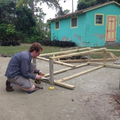 Aaron building shelves for storage trailer