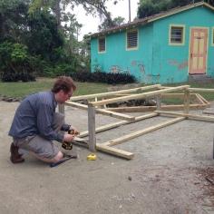 Aaron building shelves for storage trailer