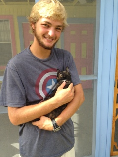Jesse Kaizer with his adopted cat, Marbles.