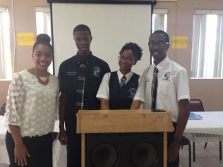 CV Bethel debate team and their coach.