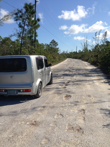 Pot holes on the only road to Red Bays make the commute slow