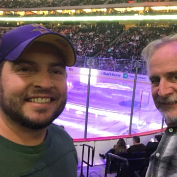 Nathaniel took Tim to a Wild Hockey game